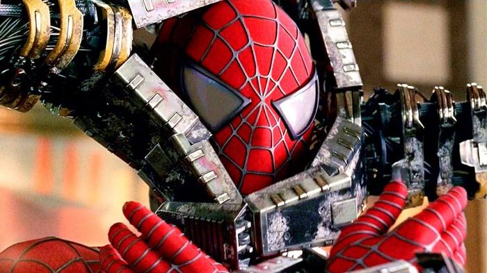spiderman clamped by doc ock with tentacles
