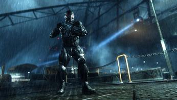 Crysis Trilogy Remastered, man in black armour holding a gun, standing on docks at night in the rain