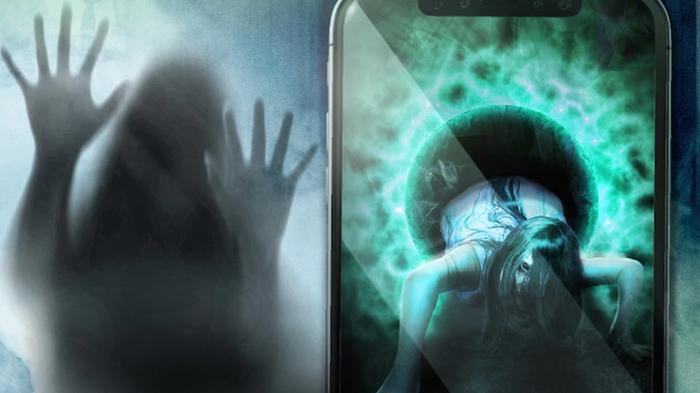 Screenshot from The Sign, showing a haunted ghost girl crawling out of a phone screen