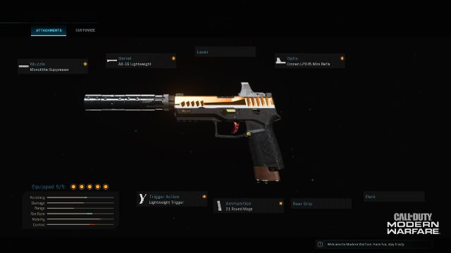 Orange Pistol Equipped With Silencer And Optic