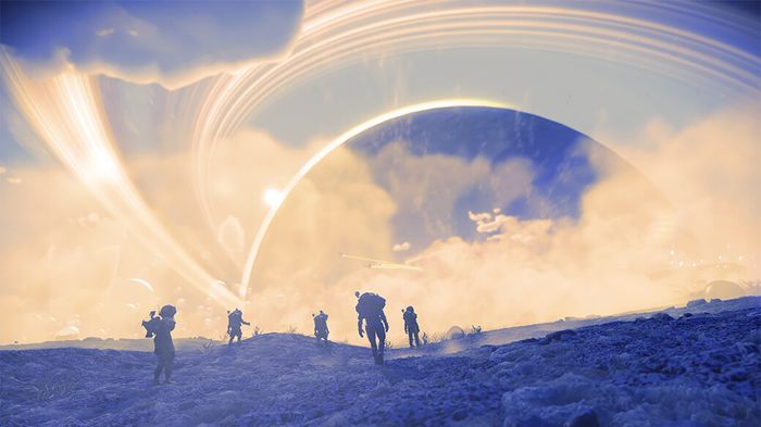 Players in No Man's Sky walk across the surface of a blue/lilac tinted planet