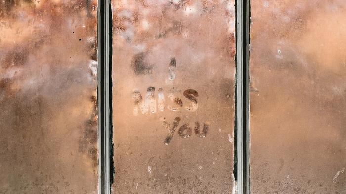 I miss you written on window condensation