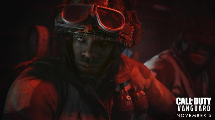 A Call of Duty: Vanguard operator looks past the camera in the dark.
