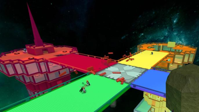 Screenshot from Super Doomspire, with red, yellow, green, and blue towers battling