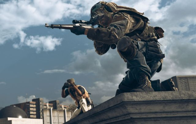 Warzone Player Sitting On Rooftop With Sniper Rifle