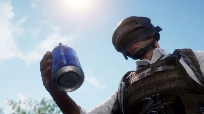 PUBG Man holding a drinks can with another, smaller player on top of it.