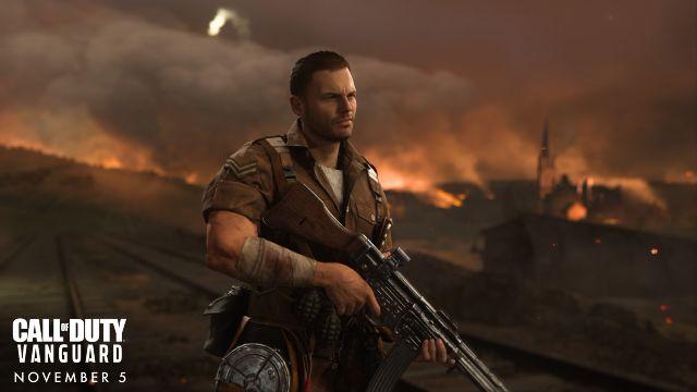Biggs Holding Machine Gun In Front Of Wartorn Background