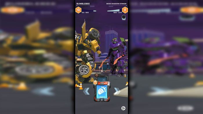 Early gameplay footage of Transformers: Heavy Metal showing Bumblebee fighting a rival transformer against an in-game backdrop.