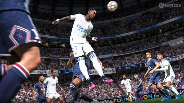 FIFA 22 screenshot showing a Real Madrid player heading the ball against Paris Saint Germain.