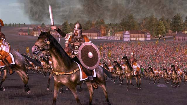 A general raises his sword ahead of a cavalry charge in Rome: Total War