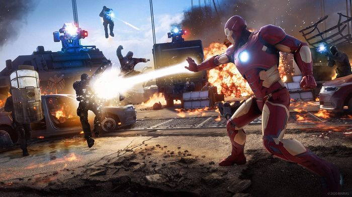 Marvel's Avengers promo picture. Iron man attacks a bad guy while the other avengers save the day.