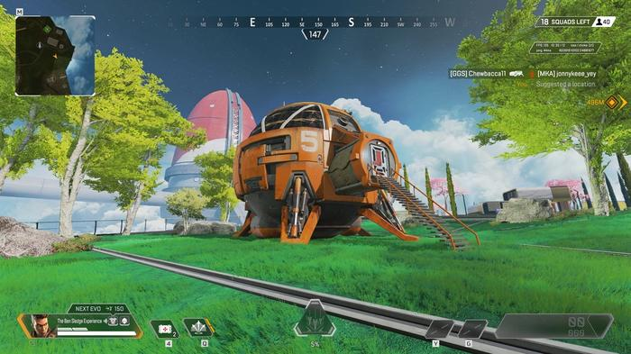 An orange space ship has landed cleanly in a green field.
