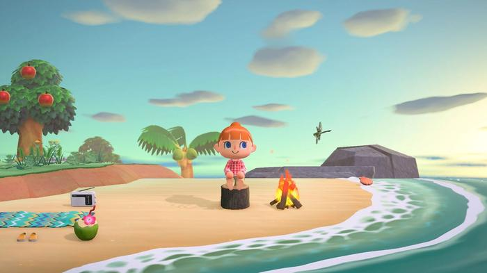 Character sits alone on beach in Animal Crossing New Horizons