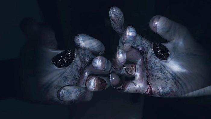 The hands of a ghost cover the vision of a player being killed during the hunting phase in Phasmophobia.