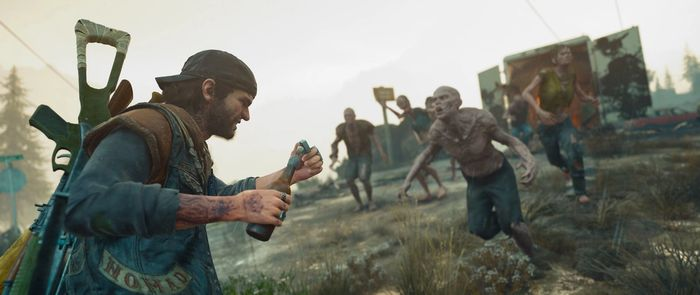 Days Gone's Deacon St. John throwing a Molotov at zombies
