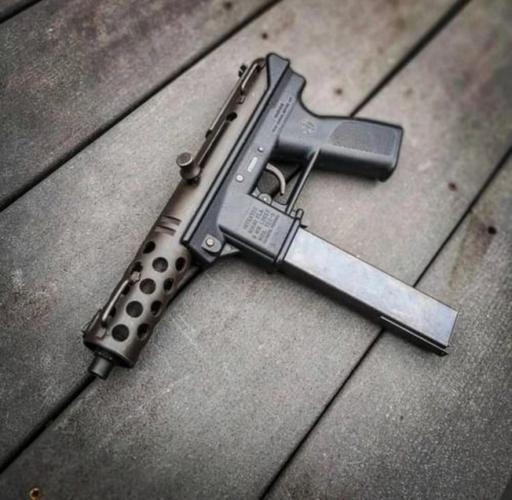 TEC-9 Pistol Placed On Wooden Floor