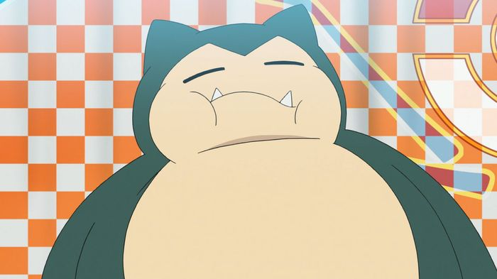Snorlax taking part in an eating content in the Pokemon anime.