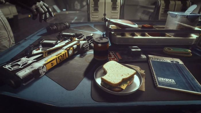 Screenshot for Starfield. it's a sandwich next to guns on a tooltable.