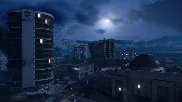Dimly lit skyscraper in darkness