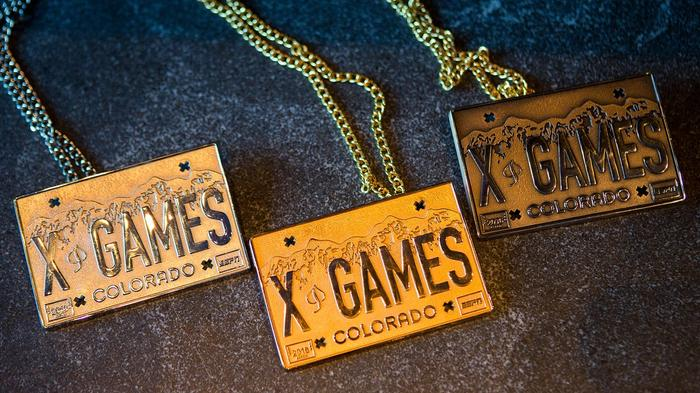 It's three necklaces earned from being in the X Games in Colorado. They're golden squares
