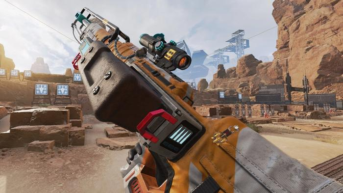 The Kraber, a sniper rifle with orange and white casing, shown against a desert background.