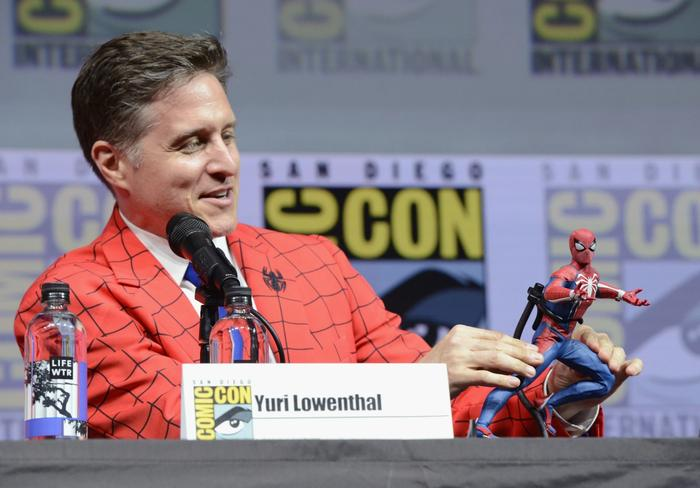 Yuri Lowenthal at San Diego Comic Con holding a Spider-Man figure, Water Bottle on Left Side
