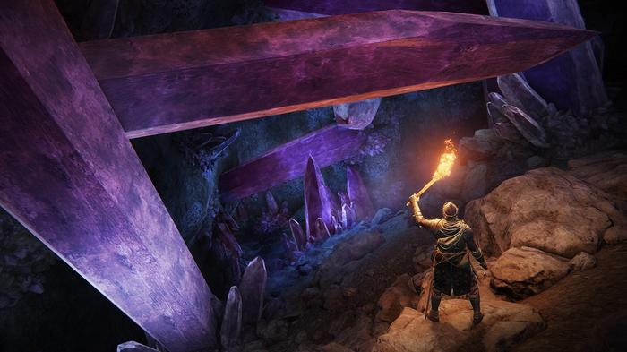 """<img src=""""ER11.jpg"""" alt=""""figure holds a torch illuminating a passage with big, purple crystals bursting from either side"""">"""