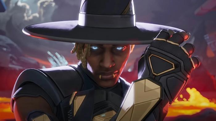 Seer looks at the camera and holds his wide-brimmed hat.