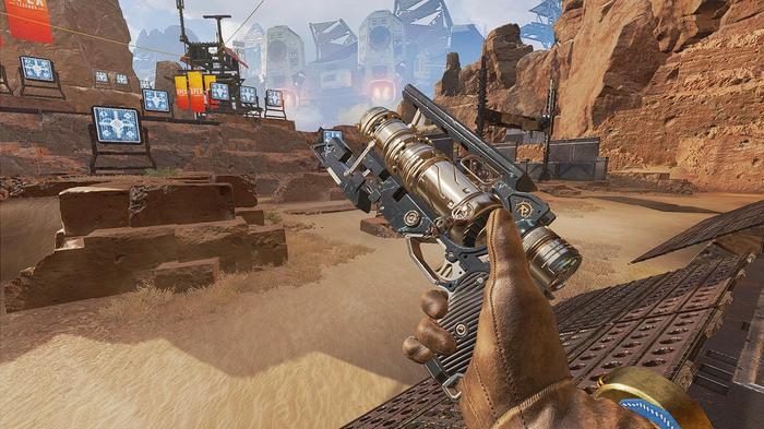 A bronze Wingman pistol shown in front of a desert.