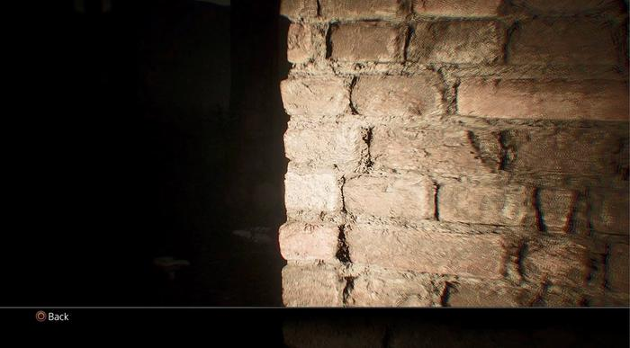Leaked screenshot from upcoming videogame Abandoned showing a flashlight illuminating a detailed brick wall