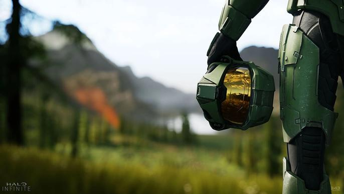 Master Chief holds his helmet by his side.