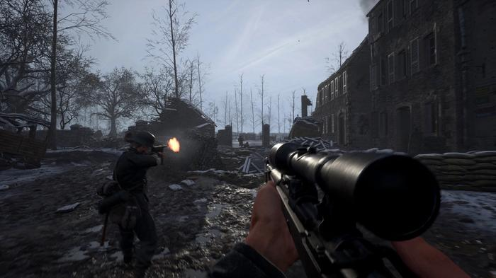 Screenshot from Hell Let Loose showing two squads battling amidst ruins.