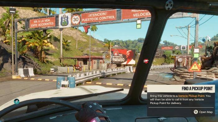 Driving a hijacked vehicle in Far Cry 6, which can be taken to any pick-up point for later use.