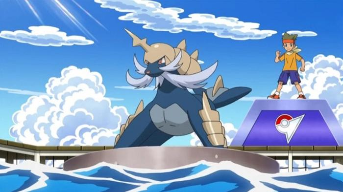 Samurott stands ready for battle on a platform floating in the sea.