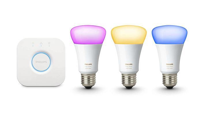 best smart light, product image of a blue smart bulb, a pink smart bulb and a yellow smart bulb with hub