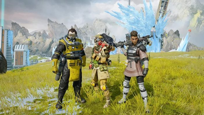 Screenshot from Apex Legends Mobile of Caustic, Bloodhound and Bangalore on a green field with Epicentre in the background.