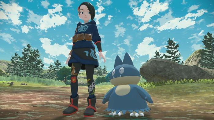 A Pokémon Warden stands in a field, looking down at her buddy Munchlax.