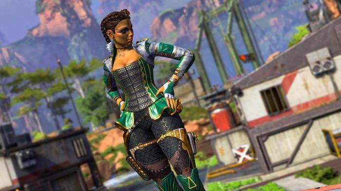 Loba, wearing black and green armour, has her hands on her hips.