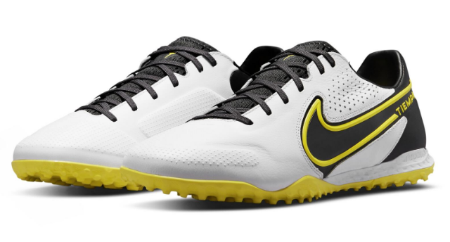 Best astroturf football boots Nike Tiempo product image of a pair of white and black boots with yellow rubber soles