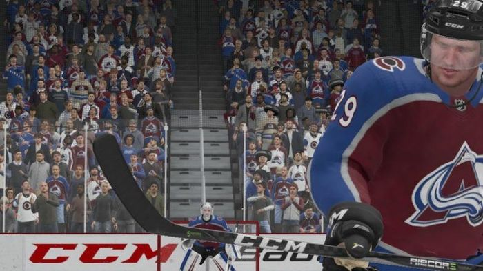 Avalanche centre Nathan MacKinnon looks across the ice in NHL 22.