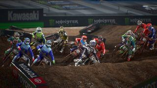 A pack of riders approaches a jump on Monster Energy Supercross 3