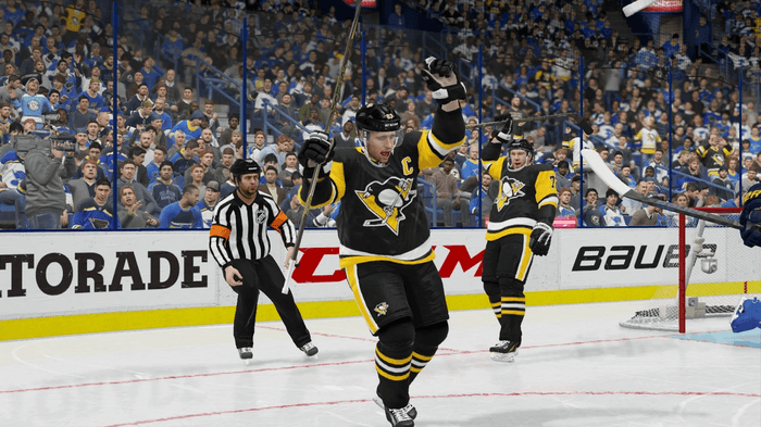 Penguins players celebrate a goal in NHL 22.