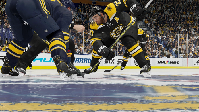 Bruins centre Patrice Bergeron lines up to take a face off at center ice in NHL 22.