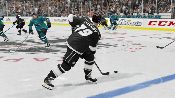 Kings defensemen handles the puck in NHL 22.