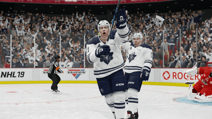 Players celebrate a goal in NHL 22.