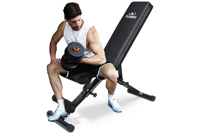 Best weight bench image of a man sitting on a workout bench