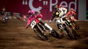 Racers tear around a dirt track in Monster Energy Supercross 3.